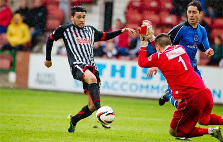 Faissal El Bakhtaoui slips the ball past David Mitchell